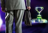 Rear view of businessman with briefcase and podium with cup