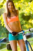happy young bicyclist riding in park