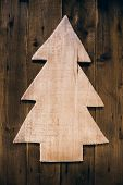 Wooden Carved Christmas Tree For A Xmas Background.