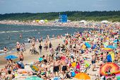 PALANGA, LITHUANIA - JULY, 27 : People on the sunny beach of Baltic Sea on July 27, 2014 in Palanga. Palanga is very popular tourist destination for summer holidays at Baltic Sea in Lithuania.