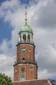 foto of evangelism  - Tower of the evangelical church in Leer Germany - JPG
