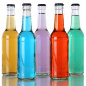 Colorful Soda And Soft Drinks In Bottles With Reflection