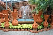 A fountain and pots in the Nong Nooch tropical botanic garden near Pattaya city in Thailand
