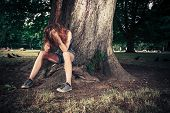 Depressed Woman Sittng Under A Tree