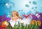 Illustration of a bathtub under the sea with a mermaid