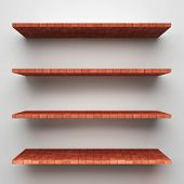 Empty brick shelves on clean soft background.
