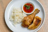 stock photo of thai cuisine  - Thai style bbq chicken with sticky rice and sweet chili dipping sauce on the white plate - JPG