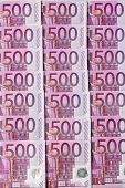 many of five hundred euro banknotes lie side by side. symbolic photo for wealth and investment