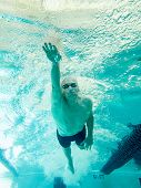 underwater view of senior swimmer swimming freestyle