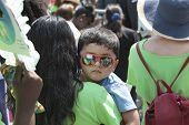 Little boy with mirrored sunglasses at rally