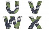 U, V, W, X alphabet from military fabric texture on white background.