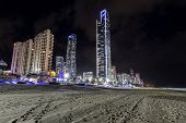 Gold Coast cityscape with Soul Building and famous beach by night