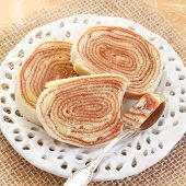 Brazilian Dessert Bolo De Rolo (swiss Roll, Roll Cake) On White Plate