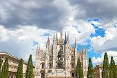 stock photo of flogging  - The Duomo Cathedral facade with statue of Vittorio Emanuele II in Milan - JPG