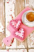 red heart cookies and espresso Coffee cup on old wooden table, shallow dof