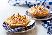stock photo of curd  - Mini orange curd and meringue tartlets for holiday - JPG
