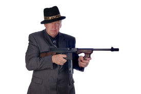 picture of sub-machine-gun  - Gangster with submachine gun isolated on white - JPG