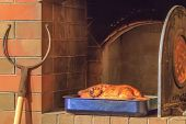 picture of roast duck  - Roasted duck at a firewood oven background - JPG