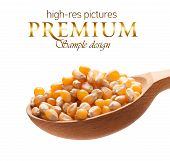 Yellow corn in a wooden spoon