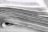 Heap of folded newspapers