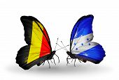 Two Butterflies With Flags On Wings As Symbol Of Relations Belgium And Honduras