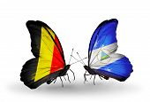 Two Butterflies With Flags On Wings As Symbol Of Relations Belgium And Nicaragua