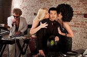 picture of groupies  - Asian DJ with fan girls kissing his cheek - JPG