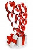 Gift in white box with red ribbons and hearts isolated on white background