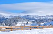 stock photo of luge  - mountain village covered with snow in winter - JPG