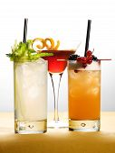 Different Drinks On Glasses With Fruits And Leaves