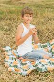 Teenage boy drinking fresh raw milk from glass