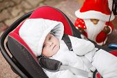 Little Baby Toddler In White Winter Clothes Sitting In Car Seat. On Cold Winter Day. Children Safety
