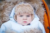 Little Baby Boy In Warm Winter Clothes Outdoor