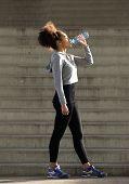 Female Runner Drinking From Water Bottle