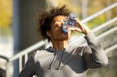 Young Sports Woman Drinking Water From Bottle
