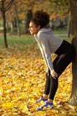 Happy Young Sports Woman Smiling Outdoors In Park