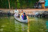Alleppey, India - February 23: An Unidentified Man And Women Are Floating In A Traditional Boat. Ind