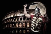 picture of legion  - Roman legionary soldier in front of coliseum at night time - JPG