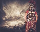 Legionary soldier against stormy sky