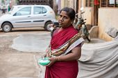 Thanjavour, India - February 14: An Unidentified Woman Holding Capacity With Rice Powder Drawing On