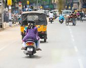 Trichy, India - February 15: An Unidentified Indian Riders Ride Motorbikes On Rural Road. India, Tam