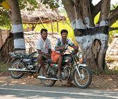 Madurai, India - February 17: An Unidentified Men Are Sitting On The Bike At The Roadside. India, Ta