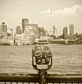 New York city observation binoculars with downtown view