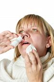 foto of rhinitis  - Sick with a rhinitis woman dripping nose medicine isolated on white - JPG