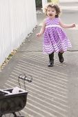 Little Girl In Pink Dress Running