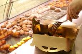 selling pastries, especially the filling of a tray