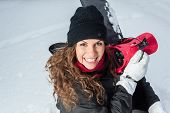 Happy Young Female Snowboarder outdoors