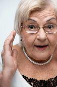 Curious granny looking at camera
