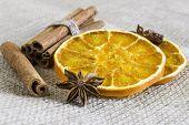 Anise Stars, Cassia Cinnamon Sticks And Dried Orange Rings On Burlap