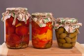 stock photo of pickled vegetables  - pickled vegetables in a glass on a wooden table - JPG